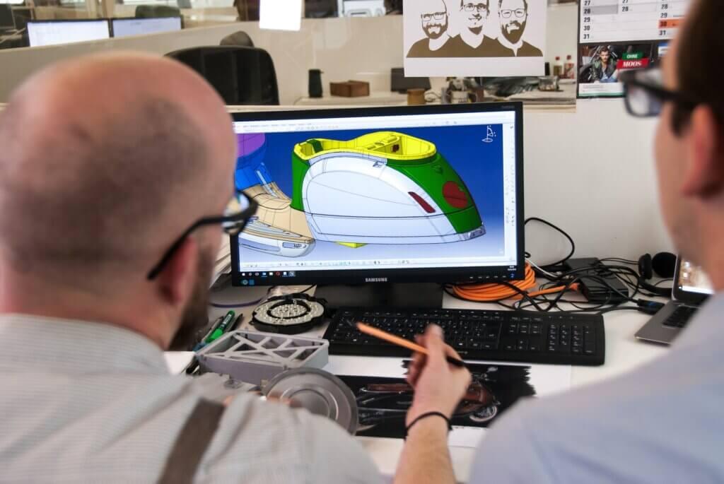 professional cad designer mentoring a drafter