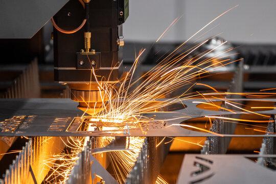 Laser cutter machine cutting through metal.